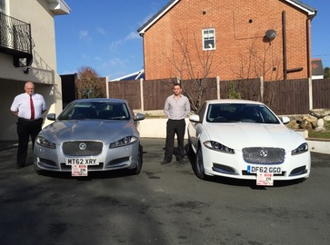 Taxi driver stood outside car - Jaguar XF Luxury - www.wrexhamandprestigetaxis.co.uk wrexham and prestige taxis
